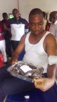 Lawrence-Achuta-donating